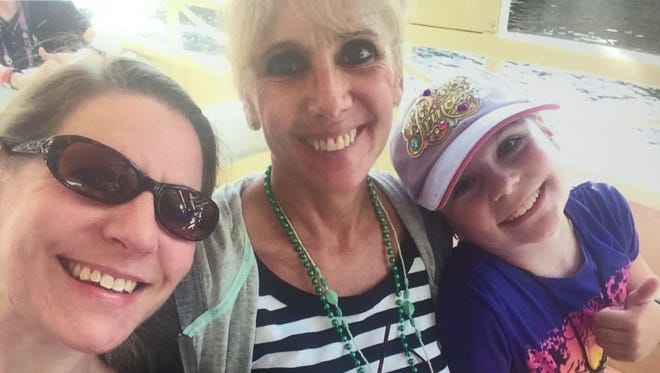 Susan Teel (center), who was shot and killed by Indian River County Sheriff's Deputy Jonathan Lozada on July 26 at her Vero Beach home after suicidal behavior, is pictured in an undated photo provided by Rubin & Rubin with her daughter, Sara Gordon (left), and granddaughter, Isobel Gordon.