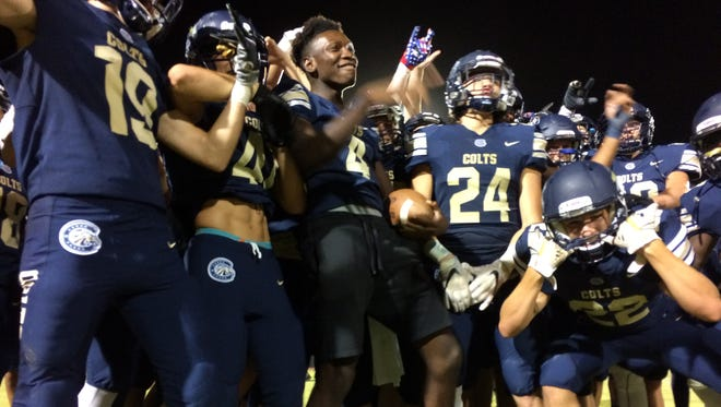 Queen Creek Casteel celebrates a huge win over Globe on Friday, Aug. 18, 2017.