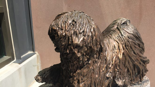 A statue of Auditor, the dog who roam the Berkeley Pit, is at the Butte-Silver Bow Archives in Uptown Butte.
