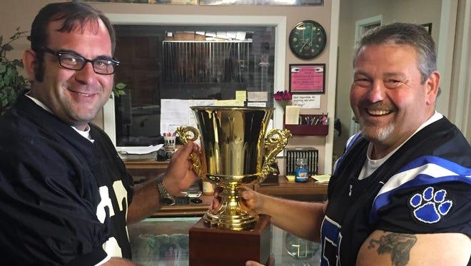 Oak Grove Mayor Adam Holland (left) and Sterlington Mayor Vern Breland (right) hoist the Mayor's Cup, sponsored by the News-Star.