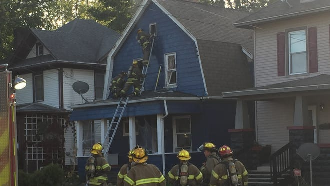 Lansing firefighters put out a blaze at a home in the 300 block of Bingham Street on Sunday, Oct. 1, 2017.