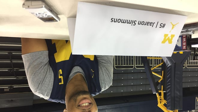 Michigan guard Jaaron Simmons talks to reporters during media day at Crisler Center on Wednesday, Oct. 25, 2017.
