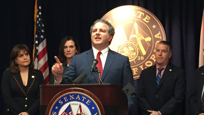 """CFO Jimmy Patronis stands before a bi-partisan group of lawmakers and puts the """"full weight"""" of his office behind a PTSD workers comp bill"""