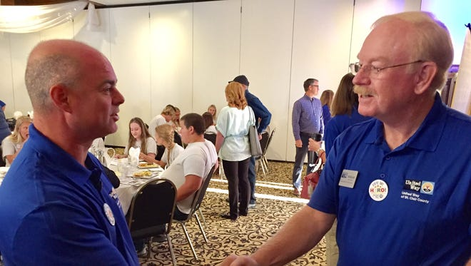 Danny Negin, left, shakes hands with Doug Dolph, executive director of the United ay of St. Clair County, during the 2017 campaign kickoff in September.