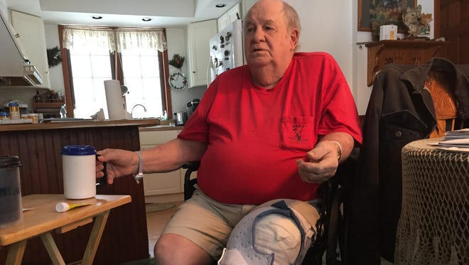 Donald Hacker discusses the impact of an infection following his July knee surgery at Sparrow Carson Hospital on Monday, Feb. 19, 2018 at his home in Six Lakes.