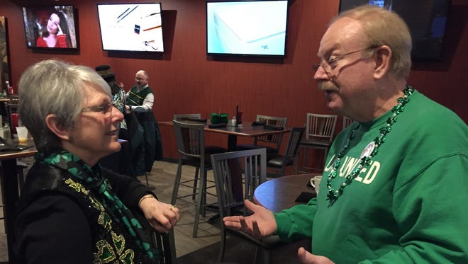 United Way director Doug Dolph visits with former director Lonnie Stevens during the annual St. Patrick's Day Breakfast fundraiser.