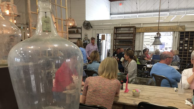 Visitors enjoy lunch and conversation at the Woerner Warehouse Country Market and Café in Fredericksburg, Texas. The building is one of four, side-by-side converted warehouses that hold antiques from around the world.