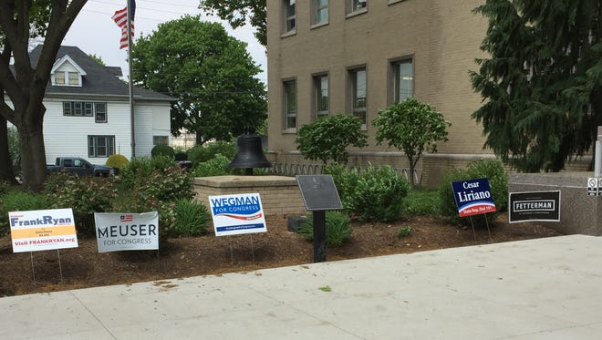 Signs line the walkway in front of the Lebanon Municipal Building at 400 S. 8th St., one of several polling places in Lebanon.