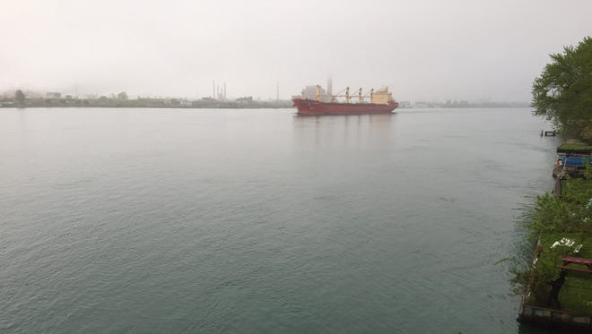 The Federal Danube moves through the fog and the mist Tuesday morning, May 22, 2018, on the St. Clair River