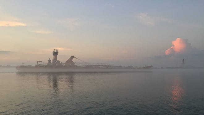 The self-unloading barge Joseph H. Thompson moves through the mist on the St. Clair River.