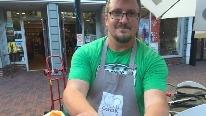 Michael Meehan holds a masala aloo dosa at the Dosa Love food cart on the Church Street Marketplace in Burlington on July 20, 2018.
