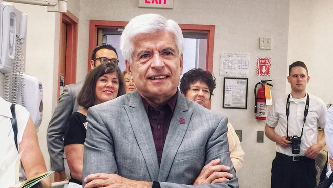 New Mexico State University Chancellor Dan Arvizu stands during a press conference at Doña Ana Community College about the school's dental program partnering with Delta Dental to bring dental services to low income families in the community.