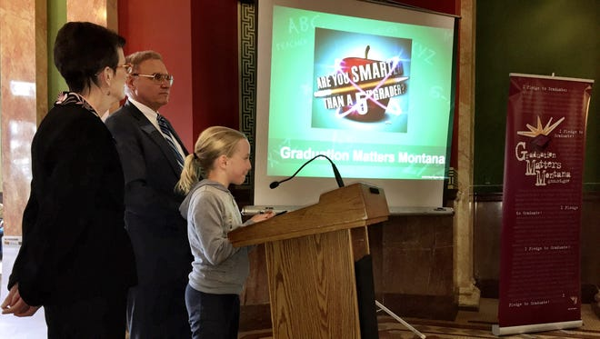 """Hawthorne Elementary School student Molly McGree helps Sen. Taylor Brown, R-Huntley, and Sen. Mary Sheehy Moe, D-Great Falls, with their answers in the contest """"Are you smarter than a 5th grader"""" Friday at the Montana Capitol."""