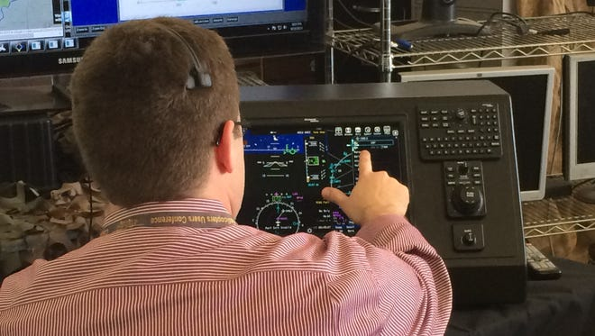 Brian Wolford, senior software engineer for the Advanced Technology Center at Rockwell Collins, uses a ground control station to direct an aircraft to a new waypoint in a demonstration last month at the Operator Performance Laboratory in Iowa City.