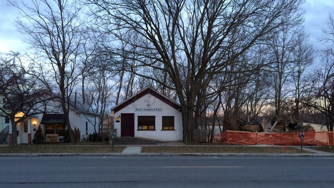 Two remaining brick cottages, dating to the mid-1800s, stand in the 600 block of South Dubuque Street in what was once Iowa City's rail district.
