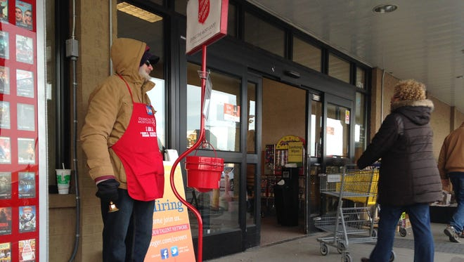 Port Huron resident Hal Gerhold stands outside Kroger at 1215 24th St. in Port Huron, raising money for the Salvation Army's Red Kettle Campaign.