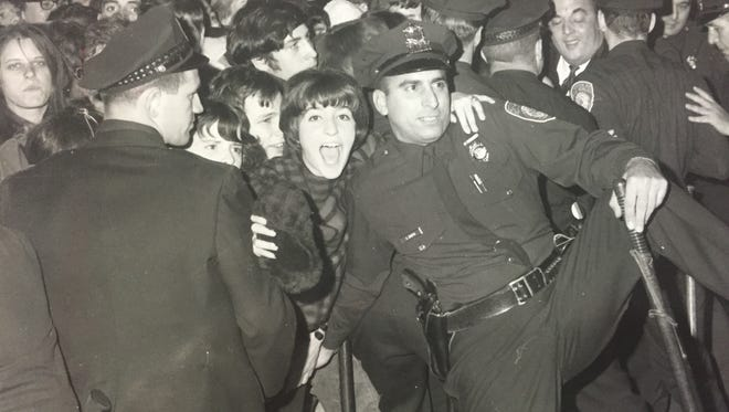 Rochester police try to control a crowd of 4,000 fans at the Rolling Stones' Nov. 1, 1965, concert at the War Memorial.
