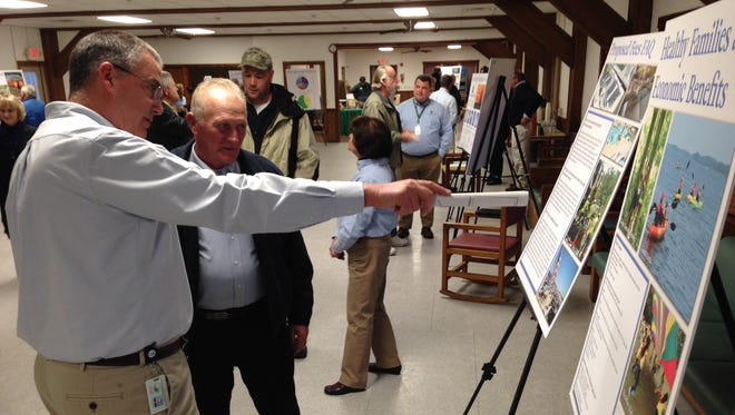 Greg Abbott of Delaware's Division of Parks and Recreation speaks with State Rep. Dave Wilson (R-Bridgeville) about the proposed increase in fees at Delaware State Parks during a recent workshop at Cape Henlopen State Park.