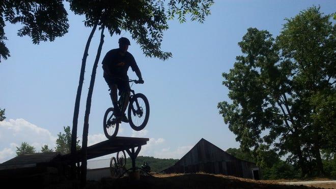 A mountain bike jump at Two Rivers Bike Park southwest of Nixa.