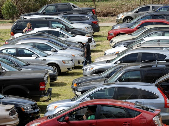 Cars are parked in a field at Cleveland Park on Saturday,