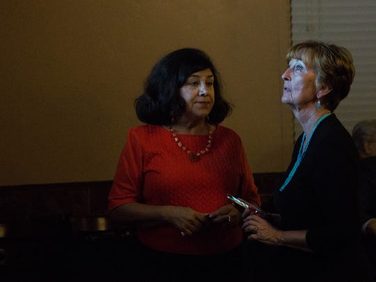 Dolores Conner, left, former Las Cruces City Councilor for district 2 talks with Ceil Levatino, left, current Las Cruces city councilor for district 6 seat as she watches the poll numbers come in at Sunset Grill, Tuesday November 7, 2017.