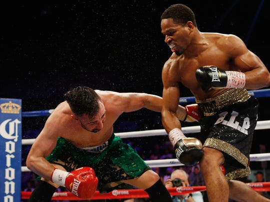 Shawn Porter, right, sends an opponent to the canvas.