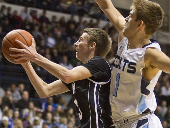 Rumson-Fair Haven's Brendan Barry. drives to the basket