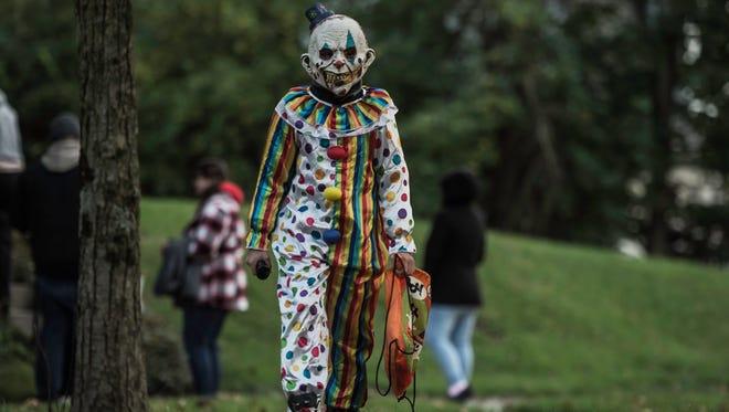 Families walk around the Reeveston neighborhood in Richmond to trick-or-treat on Halloween night, Tuesday, Oct. 31, 2017.