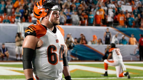 Center Kyle Cook made 16 starts for the Bengals last season.