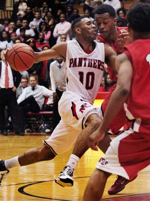 North Central's Eron Gordon rushes to the basket as the Panthers try to catch Pike High School in the final minutes of the Panthers' 67-63 loss to the Red Devils' on the Panthers' home court on Wednesday, Nov. 27, 2013. Gordon had a game-high 33 points in the losing effort.