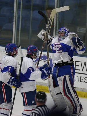 Detroit Catholic Central's Spencer Wright celebrates the 4-3 win against Detroit U-D' in the Division One Hockey Playoffs on Friday, March 13,2015 at Compuware Arena in Plymouth.