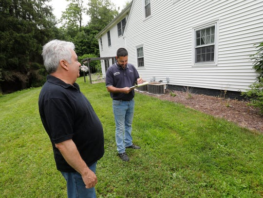 Tom Klug of Poughkeepsie has his home survey for a