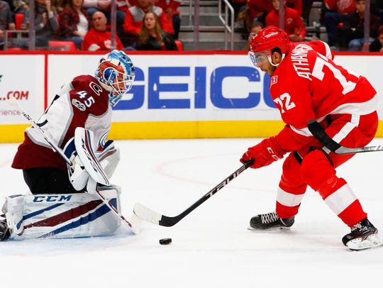 Red Wings left wing Andreas Athanasiou scores on Avalanche