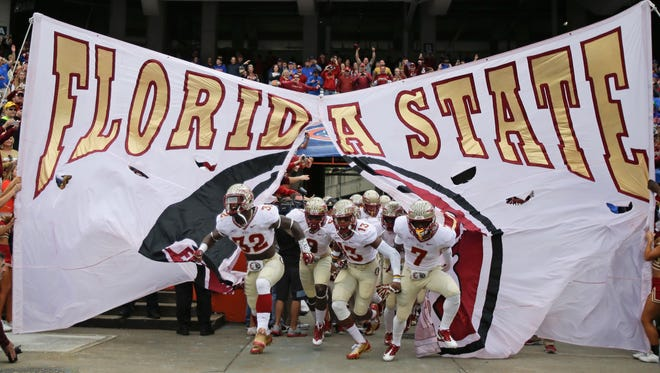Florida State players take the field on Nov. 30 in Gainesville.