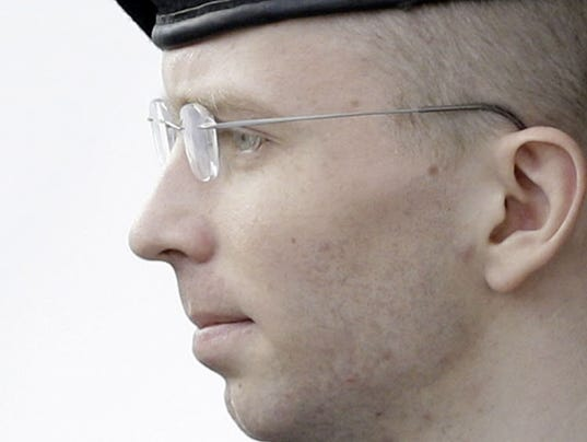 Bradley Manning is escorted to a security vehicle outside a courthouse in Fort Meade, Md