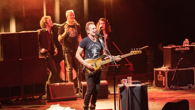 Sting and his backup singers, including his son, Joe Sumner (center) perform Saturday at The Show in Rancho Mirage.