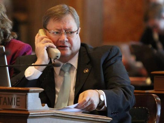 Rep. Greg Forristall, R-Macedonia, talks on the phone during their opening day of the 2012 Legislature at the Iowa State Capitol.