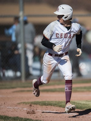Cedar baseball smacked 12 hits to beat Pine View in the first of a two-game series.