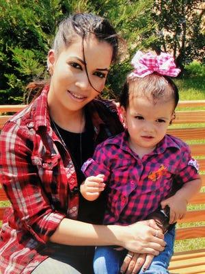 Natasha Cadena with her young daughter, Bella. Cadena comitted suicide recently.