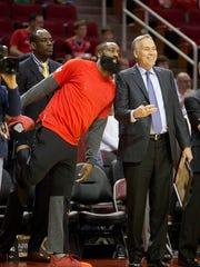 Houston Rockets guard James Harden (13) and head coach