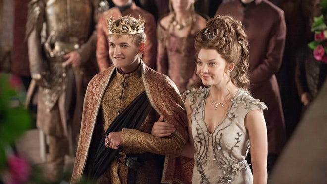 Going to the chapel and we're gonna form an alliance: King Joffrey (Jack Gleeson) and Margaery Tyrell (Natalie Dormer) tied the knot in Sunday's 'Game of Thrones.'