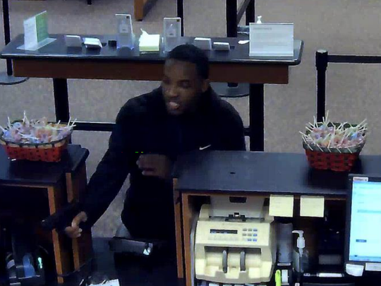 Devontae T. Amos, 25, of Milwaukee is a suspect in multiple armed robberies. This picture is from surveillance camera footage from a Wells Fargo Bank branch in West Allis on May 9.