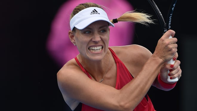 Angelique Kerber of Germany returns to Lucie afárová of the Czech Republic in their first-round match at the Sydney International.