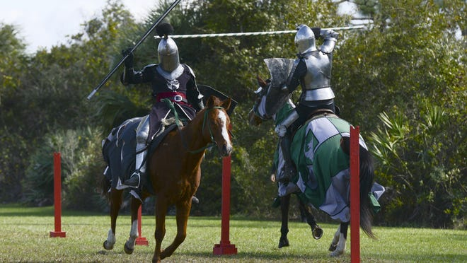 A pair of knights from The Stormy Knights group demonstrates jousting during The Dragon Festival Saturday in Melbourne.