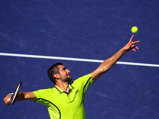 Marin Cilic of Croatia serves to David Goffin of Belgium in the first set on Thursday, March 17, 2016 during the BNP Paribas Open in Indian Wells, Calif. Goffin won 7-6(4), 6-2.
