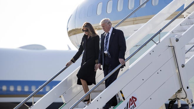 President Donald Trump and first lady Melania Trump walk down the stairs of Air Force One on their arrival to the Fiumicino Airport in Rome, Italy, 23 May 2017.