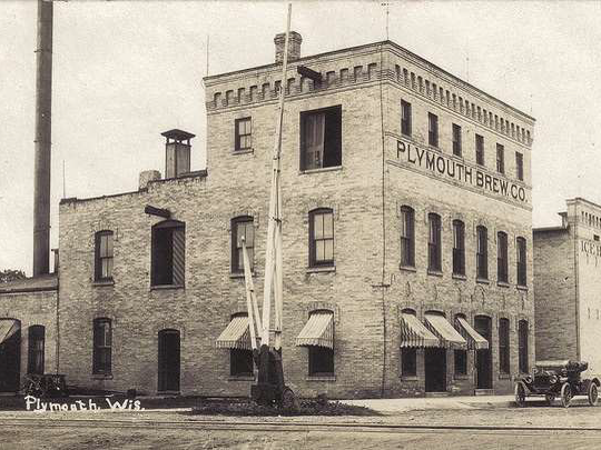 The Plymouth Brewing Company building, seen here in 1910, later became the headquarters of the S & R Cheese Company in 1943.