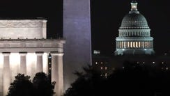 Lights shine at The U.S. Capitol along with the Washington
