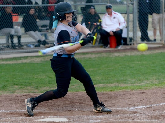 South Gibson's Madelyn Mosier swings at a pitch during Thursday's game against South Side.