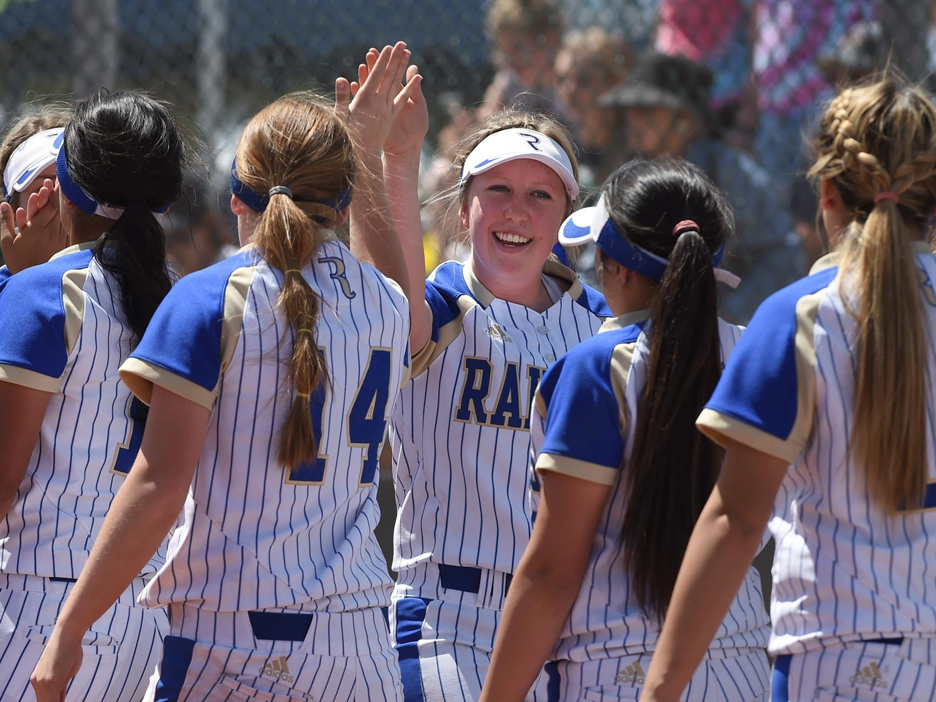 Reed celebrates its win against Bishop Manogue in the Northern Region tournament at Manogue on Thursday.
